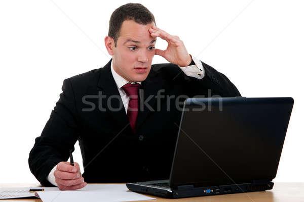 Empresário surpreendido olhando computador isolado branco Foto stock © alexandrenunes
