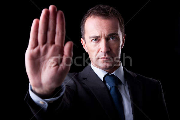 Businessman with his hand raised in signal to stop Stock photo © alexandrenunes