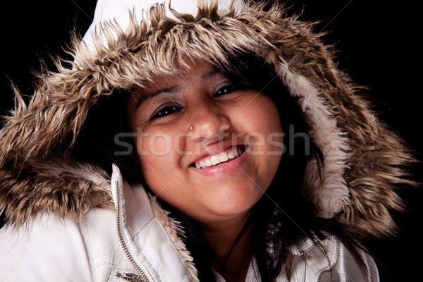 Portrait of a young latin woman with a furry hood , in autumn/winter clothes- Stock photo © alexandrenunes