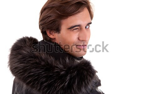 Portrait of a young man winking from back, in autumn/winter clothes, isolated on white. Studio shot Stock photo © alexandrenunes