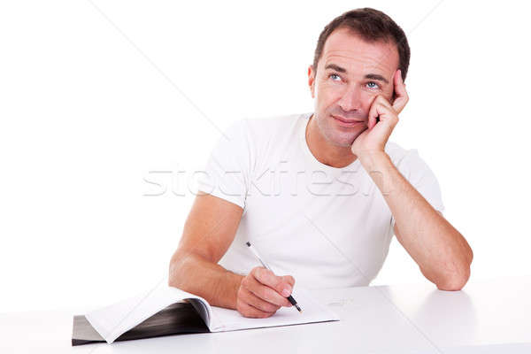 Portrait of a middle-age man thinking and writing, looking up Stock photo © alexandrenunes