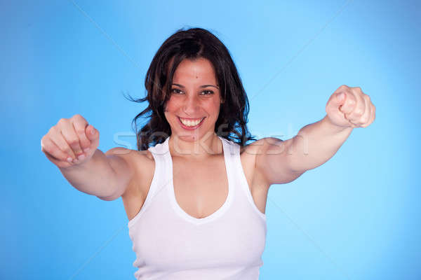 beautiful woman with arms raised as victory signal Stock photo © alexandrenunes