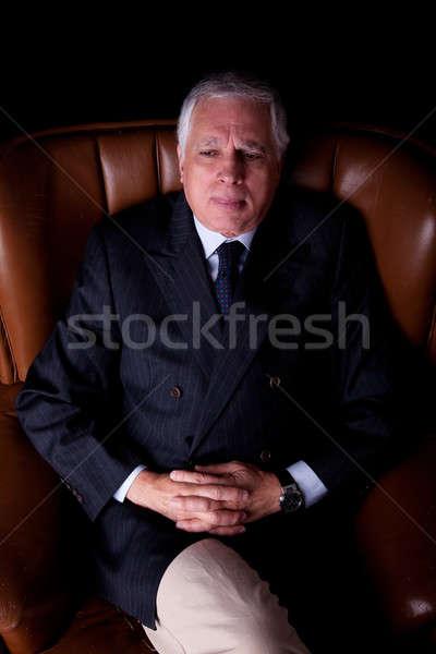 Pensativo maduro empresário cadeira isolado Foto stock © alexandrenunes