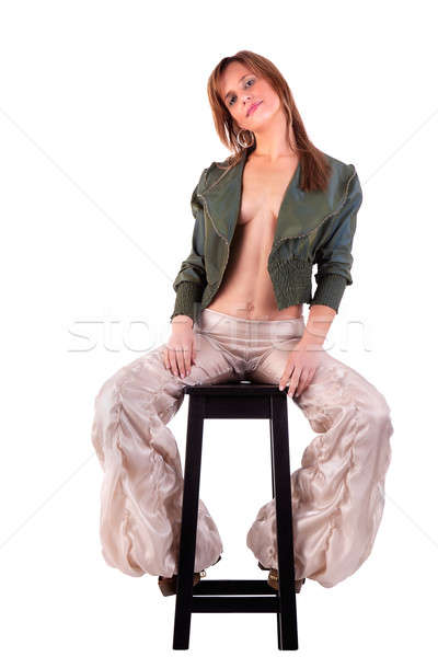 beautiful middle-age woman, sitting on a black bench Stock photo © alexandrenunes