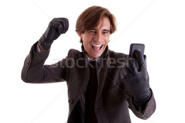 Portrait of a young happy businessman looking to the phone, in autumn/winter clothes Stock photo © alexandrenunes