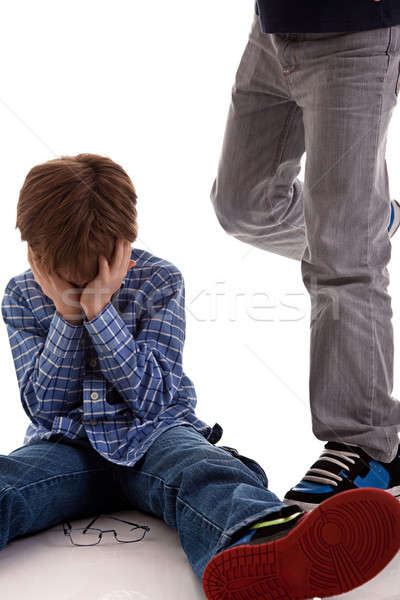 child crying on the floor being kicked by a teenager Stock photo © alexandrenunes