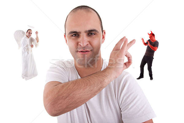young man with a finger removing the devin, from is on the shoulder, angel won Stock photo © alexandrenunes