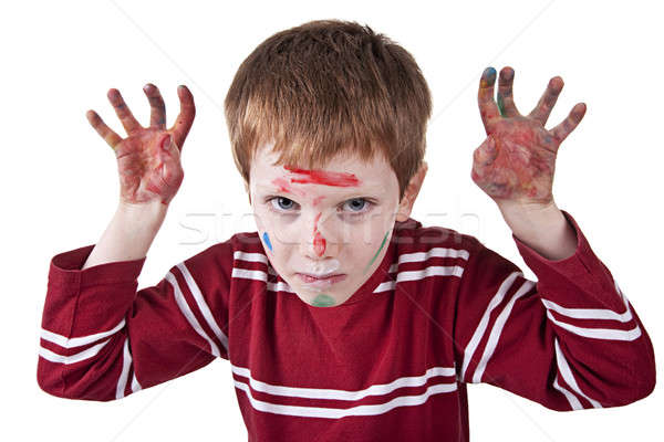Child simulating threat, with both hands painted red and raised Stock photo © alexandrenunes
