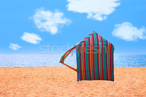 colored hut on a deserted beach with the sea as background Stock photo © alexandrenunes