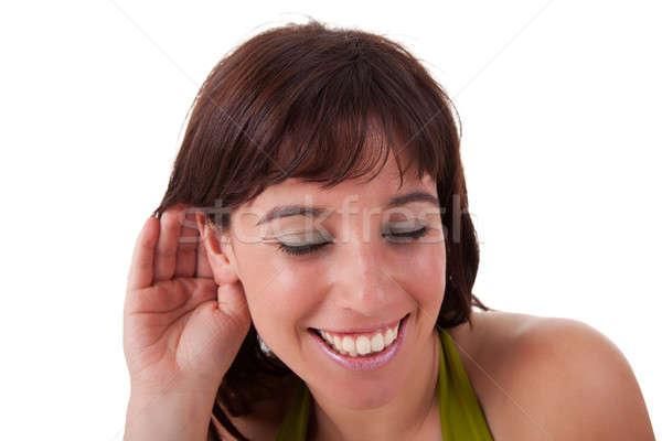 Mulher jovem escuta sorridente gesto mão atrás Foto stock © alexandrenunes