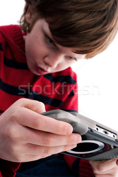 Young boy playing handheld game console Stock photo © alexandrenunes