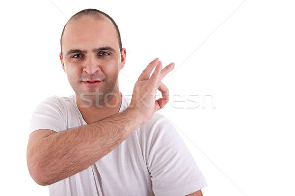 young man with a finger to remove something that is on the shoulder Stock photo © alexandrenunes