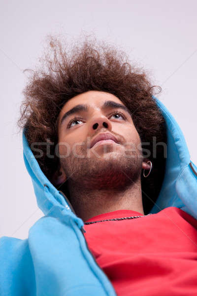 handsome man with a hood, view from below Stock photo © alexandrenunes