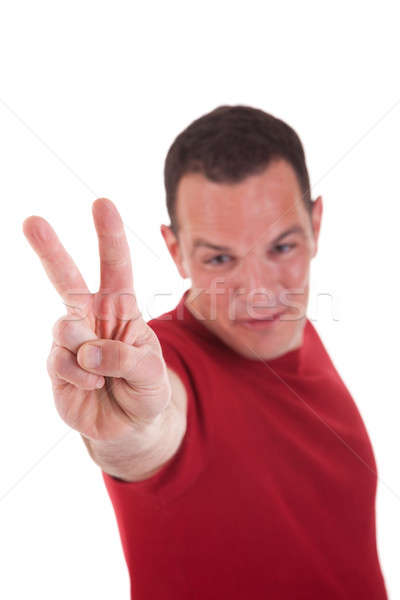 man with arm raised in victory sign Stock photo © alexandrenunes