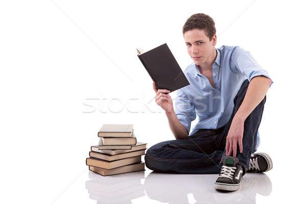Sevimli erkek okuma kitap zemin yalıtılmış Stok fotoğraf © alexandrenunes