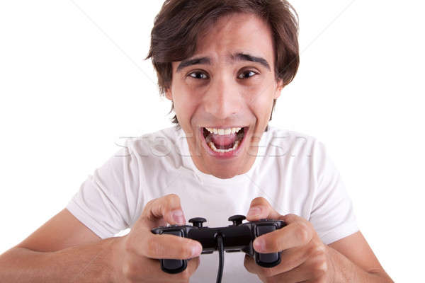 Handsome man, playing with gamepad Stock photo © alexandrenunes