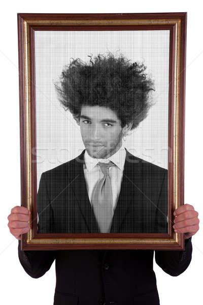 man holding a decorative frame and standing inside it on black and white Stock photo © alexandrenunes