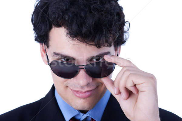 Portrait of a handsome young man with sun glasses smiling Stock photo © alexandrenunes