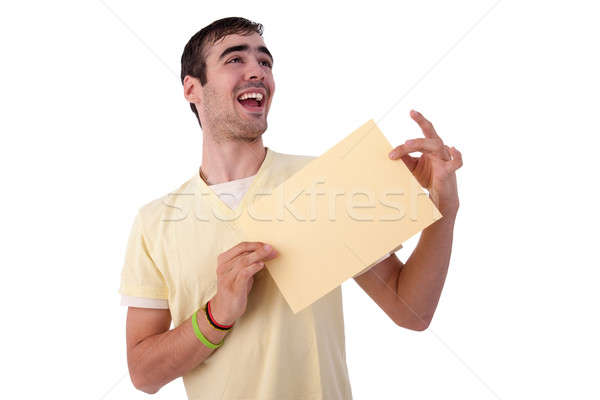 young smiling man holding a yelow sheet of paper in his hand Stock photo © alexandrenunes