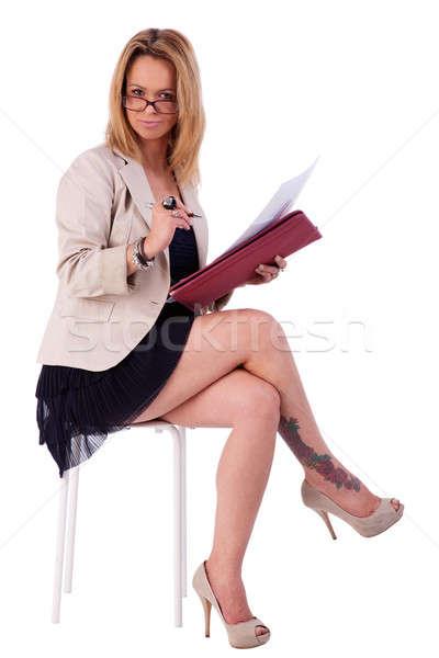 beautiful mature woman, secretary seated on a bench, reading some documents Stock photo © alexandrenunes