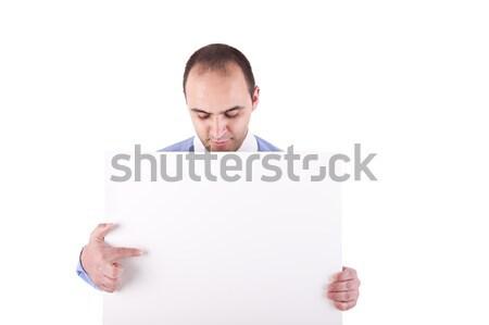 Stock fotó: Fiatal · üzletember · tart · fehér · tábla · mutat · lefelé · néz