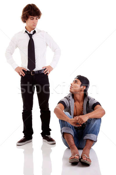two men of different ethnicity, one sitting looking at the other standing Stock photo © alexandrenunes