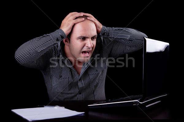 Empresário surpreendido olhando computador isolado preto Foto stock © alexandrenunes