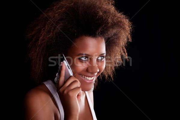 Beautiful black woman happy on the phone Stock photo © alexandrenunes