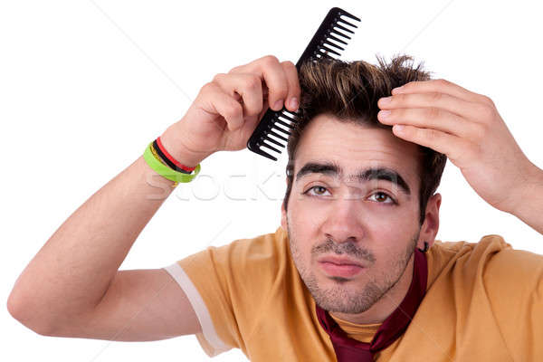 young man combing his hair with a comb Stock photo © alexandrenunes