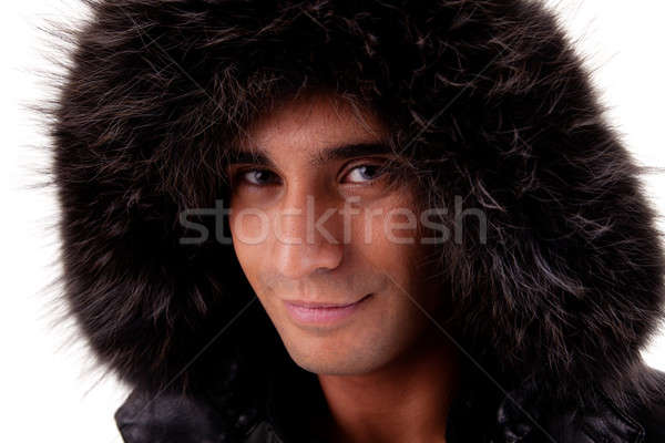 Portrait of a young man with a furry hood , in autumn/winter clothes Stock photo © alexandrenunes