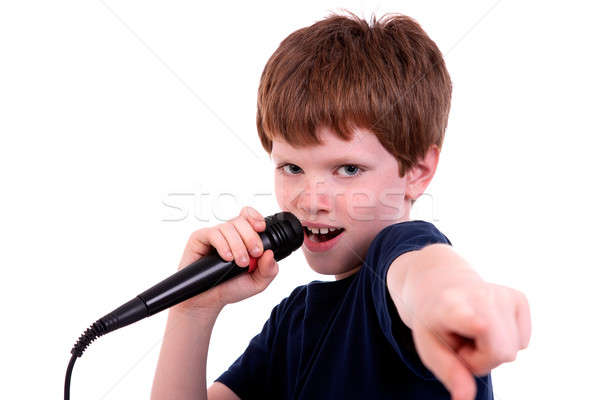 Cute boy with a microphone sings Stock photo © alexandrenunes