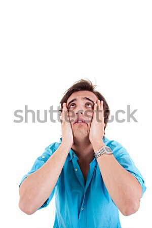 Strongly afflicted young man, with hands on face Stock photo © alexandrenunes