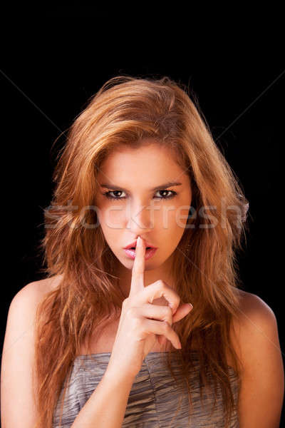 Young woman asking for silence , with golden reflexion Stock photo © alexandrenunes