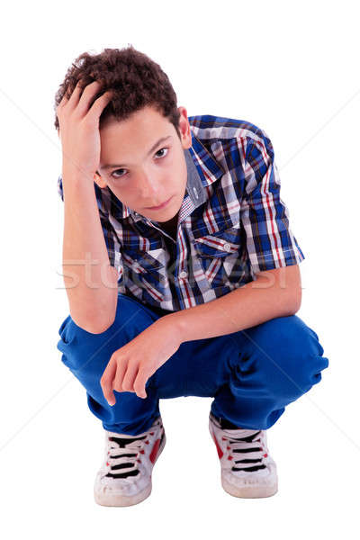 young man squatting, worried Stock photo © alexandrenunes