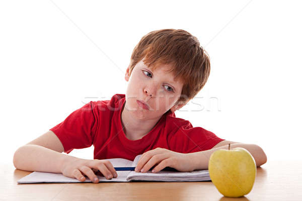 boy studying and distracted with an apple Stock photo © alexandrenunes