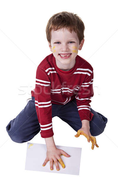 Children playing with paint, stamping his hand on a white sheet Stock photo © alexandrenunes