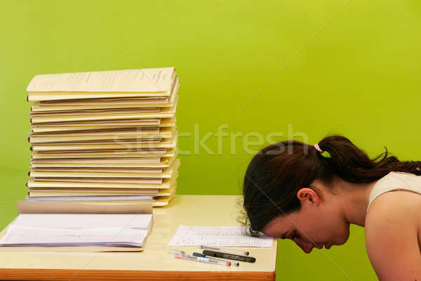 woman has stress because of huge work on her desk Stock photo © alexandrenunes