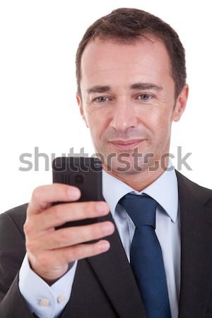 Empresário olhando telefone isolado branco Foto stock © alexandrenunes