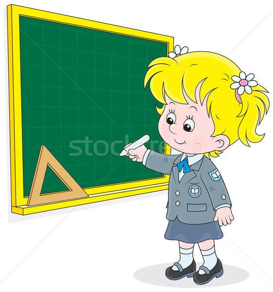 Schoolgirl writes on the blackboard Stock photo © AlexBannykh