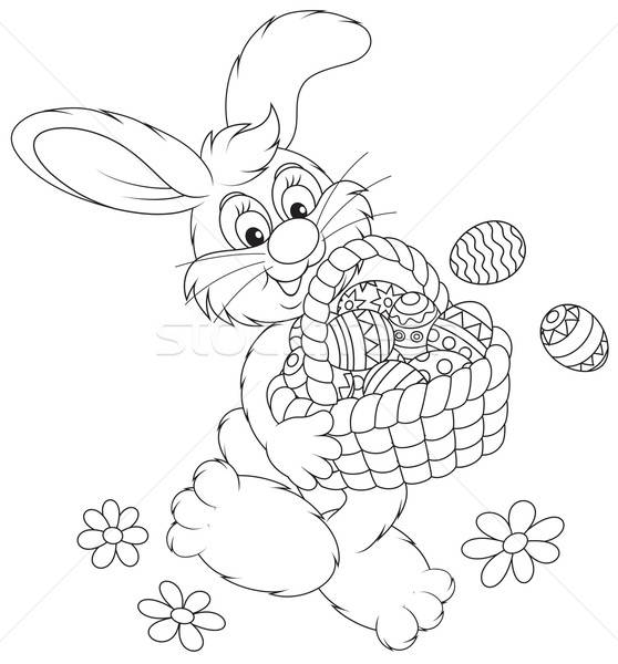 Easter Bunny with a basket of eggs Stock photo © AlexBannykh