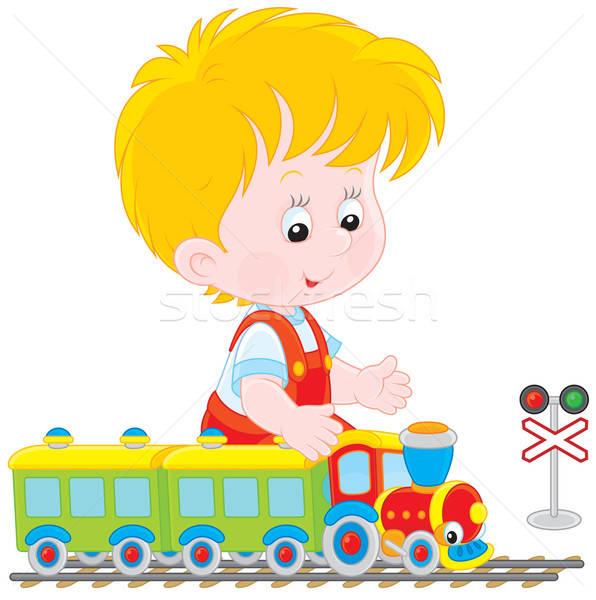 Child playing with a train Stock photo © AlexBannykh