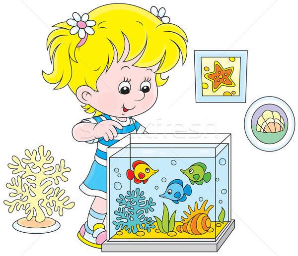 Girl looking at aquarium fishes Stock photo © AlexBannykh