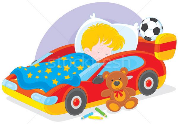 Menino adormecido pequeno cama esportes carro Foto stock © AlexBannykh