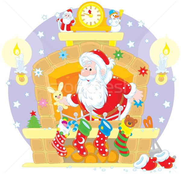 Santa in the fireplace Stock photo © AlexBannykh