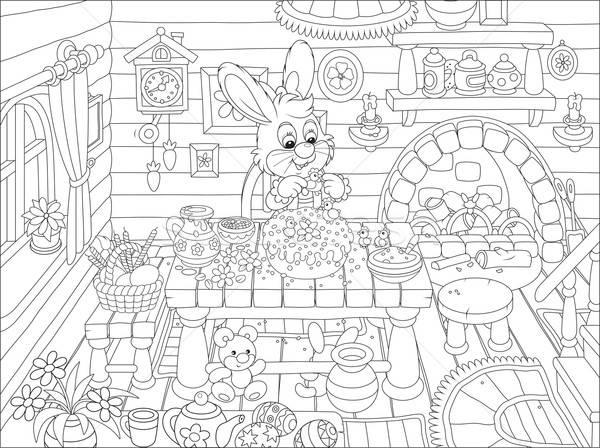Easter bunny cooks a holiday cake Stock photo © AlexBannykh