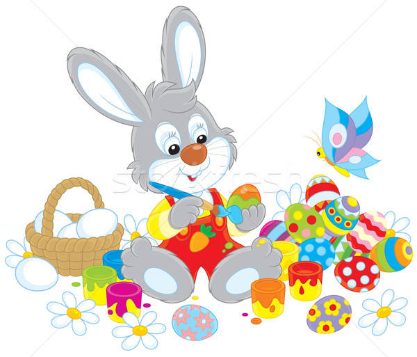 Little Bunny paints Easter eggs Stock photo © AlexBannykh