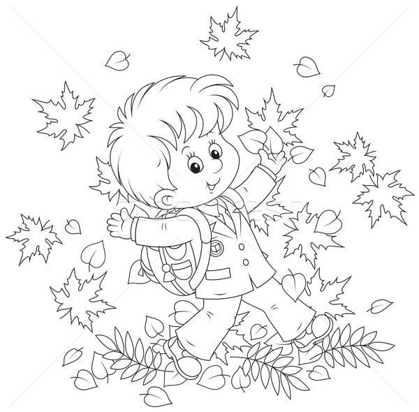 Schoolboy with autumn leaves Stock photo © AlexBannykh