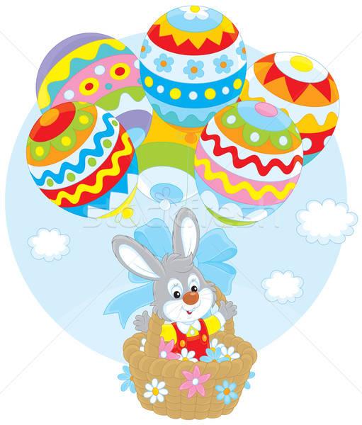 Easter Bunny flies with balloons Stock photo © AlexBannykh