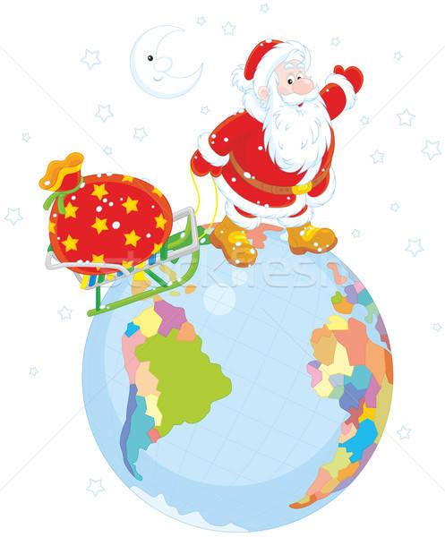Santa with gifts on a globe Stock photo © AlexBannykh
