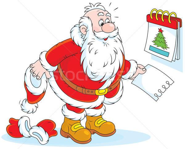 Santa Claus and a tear-off calendar Stock photo © AlexBannykh